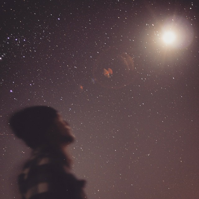 My husband looking up at the New Mexico night sky